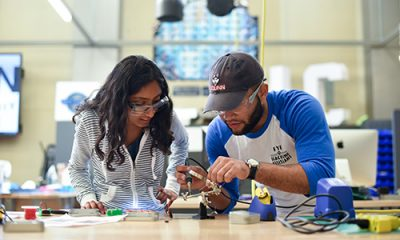 Learning Communities at the Learning Community Innovation Zone (STEM) students soldering
